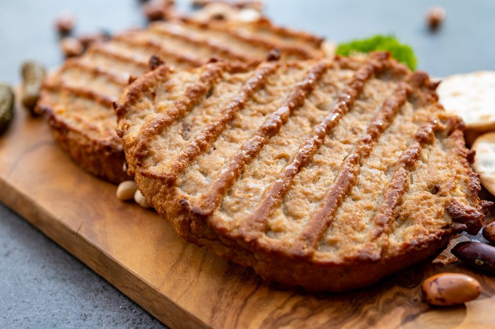Plant-based meatless patties on a cutting board