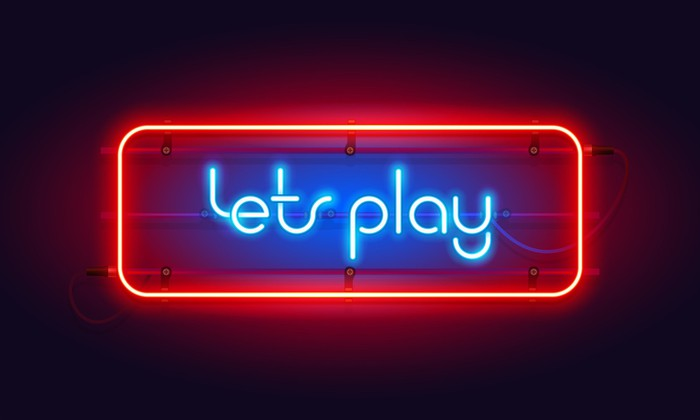 """A red and blue neon light display that reads """"lets play""""."""