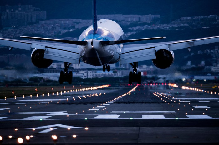 An airplane taking off from the tarmac.