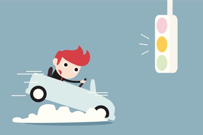 Cartoon car braking for a yellow light
