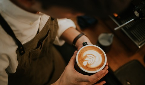 Barista Looking at Cup of Coffee