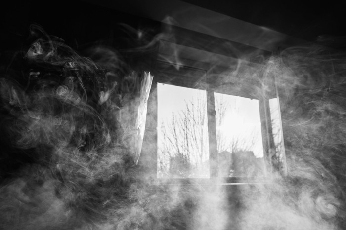 Smoke filled room in black and white