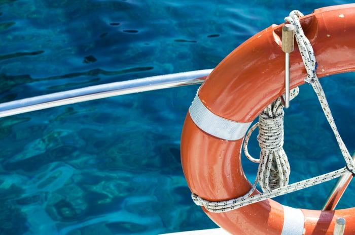 A life preserver against a ship's railing.