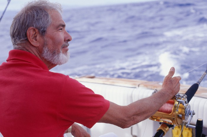 A man fishes from his boat