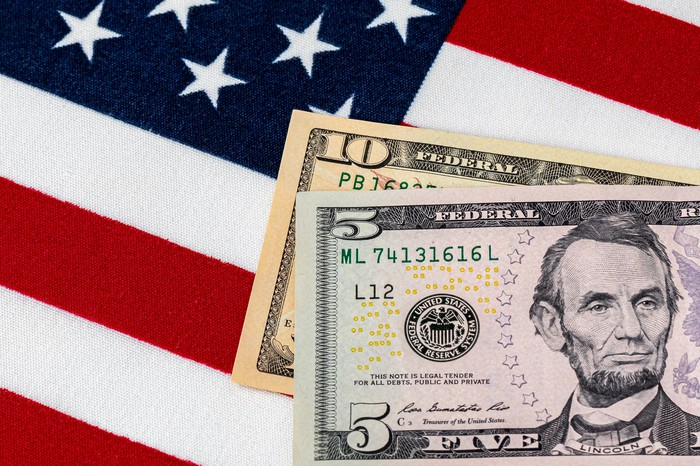 $5 and $10 bill on American flag