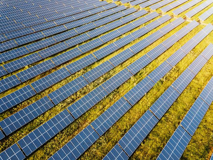Large solar panel farm in a field