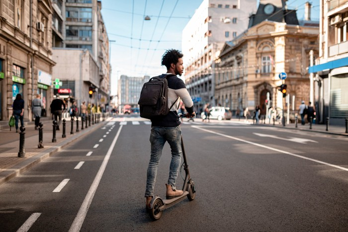 Man riding an e-scooter in a city