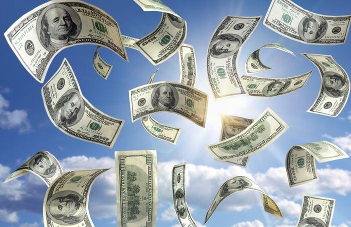 Hundred-dollar bills floating in the sky