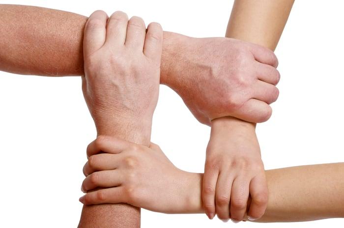 Four interlocking arms.