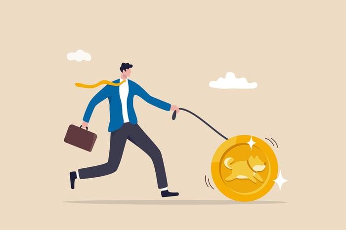 Man walking a shibu ina coin