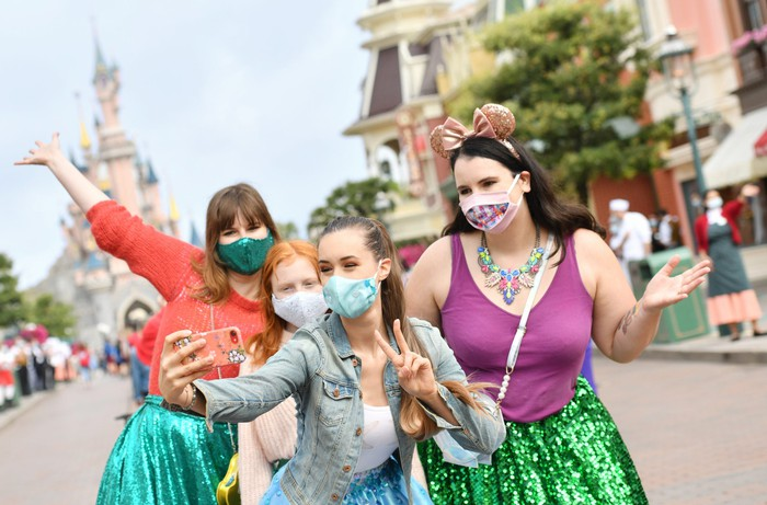 Four guests taking a selfie at Disneyland Paris during last summer's short-lived reopening.