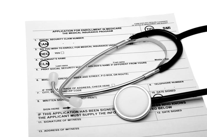 Stethoscope over Medicare enrollment form.
