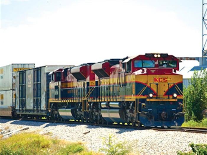 A Kansas City Southern train on the rails.