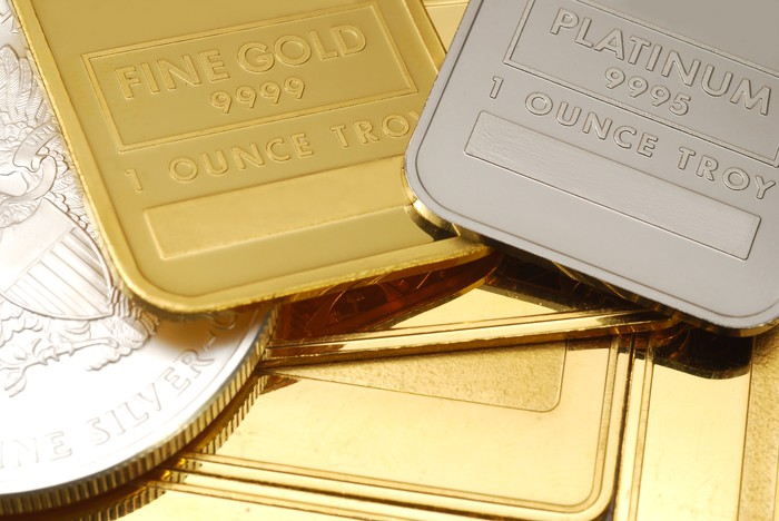 Gold and platinum bars side by side