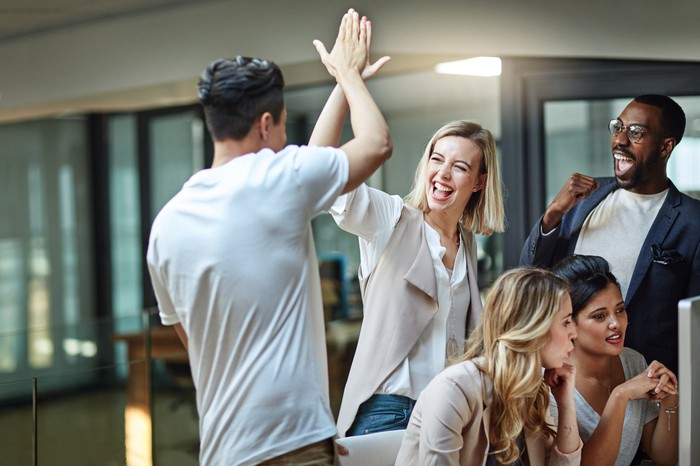 High five among colleagues