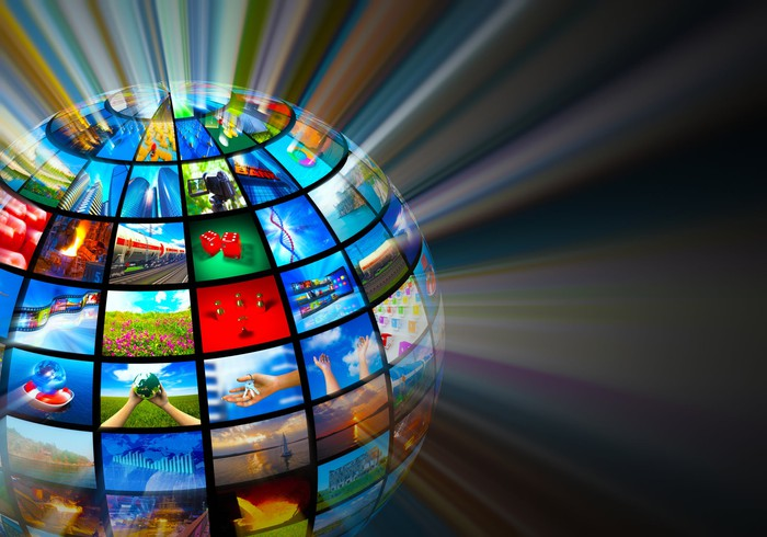 A globe divided into rectangular TV screens each with a different picture on them emanating light.
