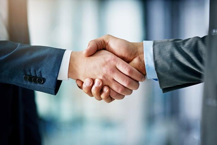 Closeup on a handshake between businessmen.