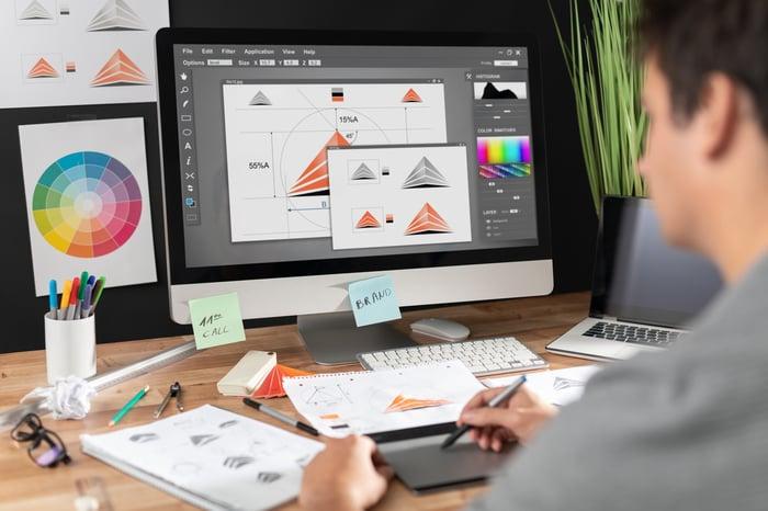 A designer uses graphical design software.