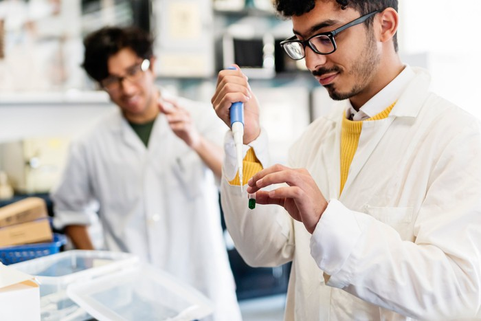 Two scientists working in a laboratory.