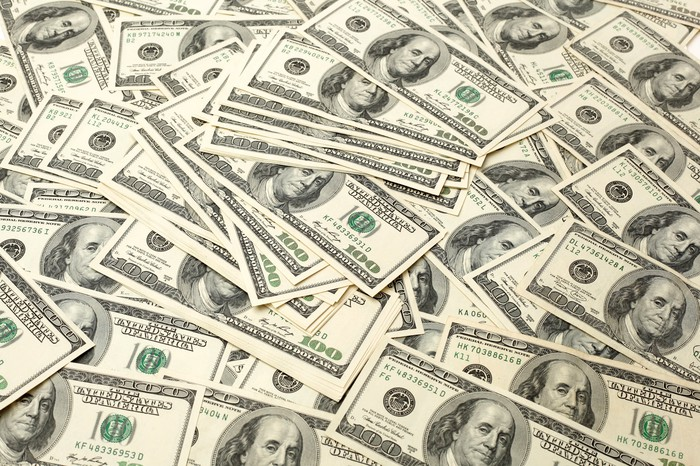 A large pile of hundred dollar bills