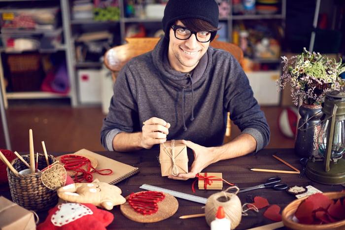 Man designing customized gifts.