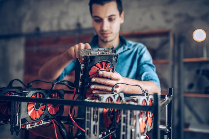 A man sets up a cryptocurrency mining rig.