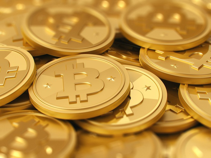 Pile of gold Bitcoin tokens