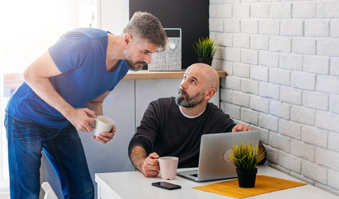 GettyImages-two men_discuss_pensive mood_computer