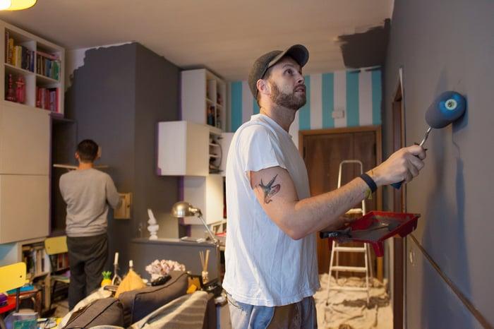 A man painting his walls.