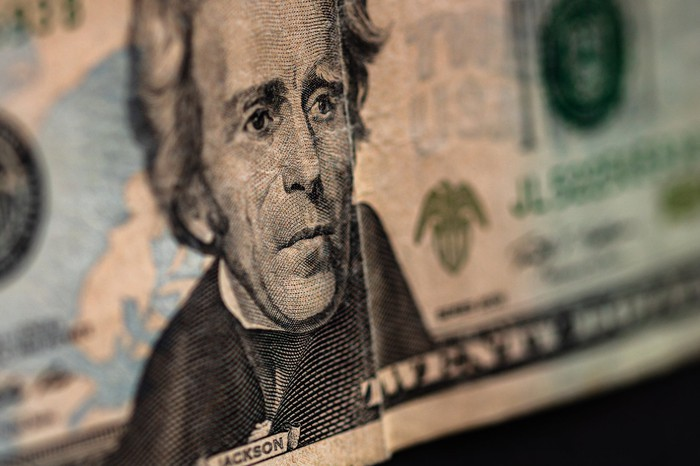 a closeup view shows Andrew Jackson's profile from the $20 bill. Twenty-dollar bill