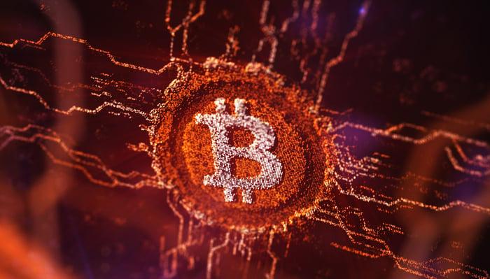 A Bitcoin logo on a digital network.