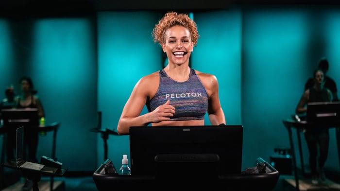 Female Peloton instructor running on a treadmill