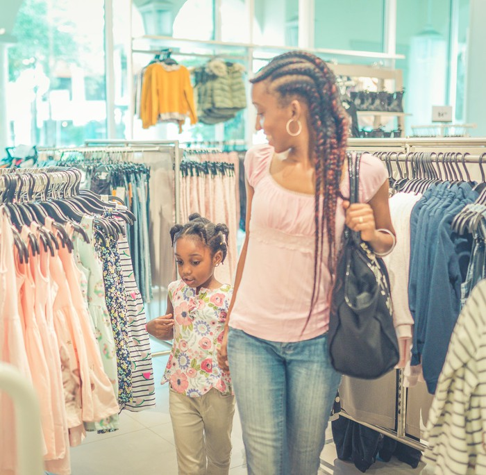 A mom and daughter shopping for clothes together
