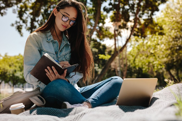 A woman studying outside.