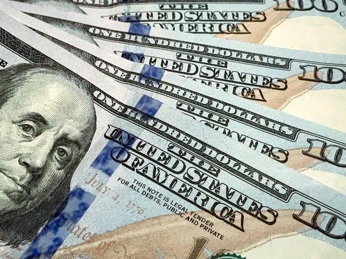 Four $100 bills.