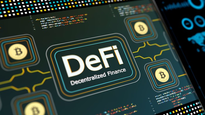 Screen bearing the words: DeFi Decentralized Finance, surrounded by Bitcoin logos.