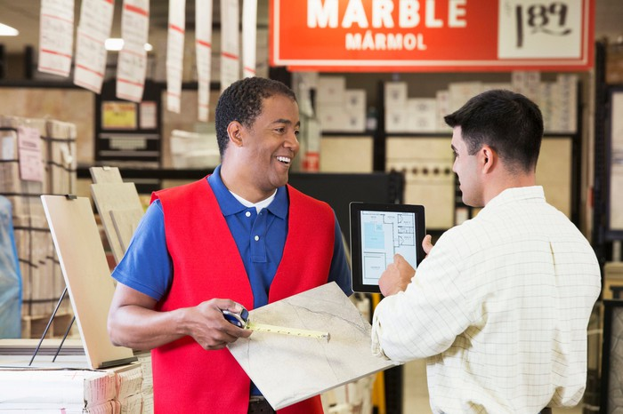 two people talking at a home improvement store