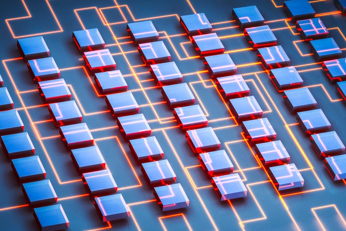 Picture of digital square chip-like items linked together by digital lines.