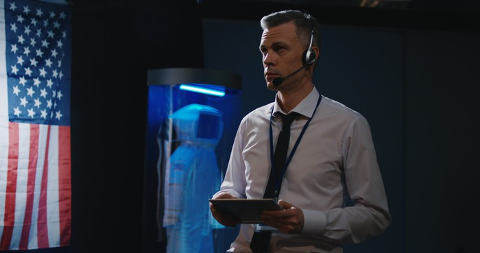 A mission control operator monitors a mission from a tablet.