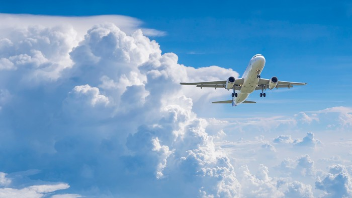 A plane soars amid the clouds.