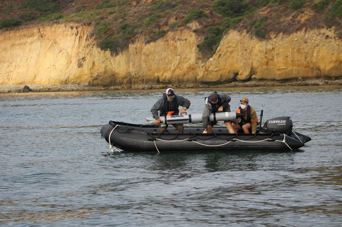 REMUS 300 being deployed from a rigid hull inflatable boat.