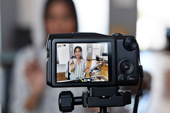 A video camera recording someone talking.