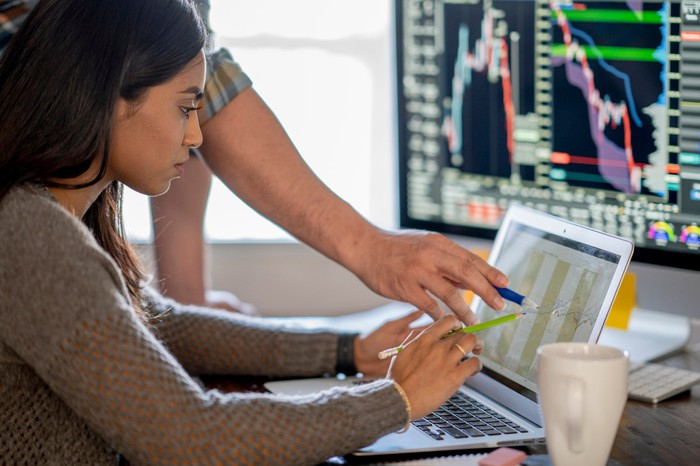 An investor reviewing a chart on a computer.
