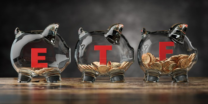 Three glass piggy banks labeled with the letters
