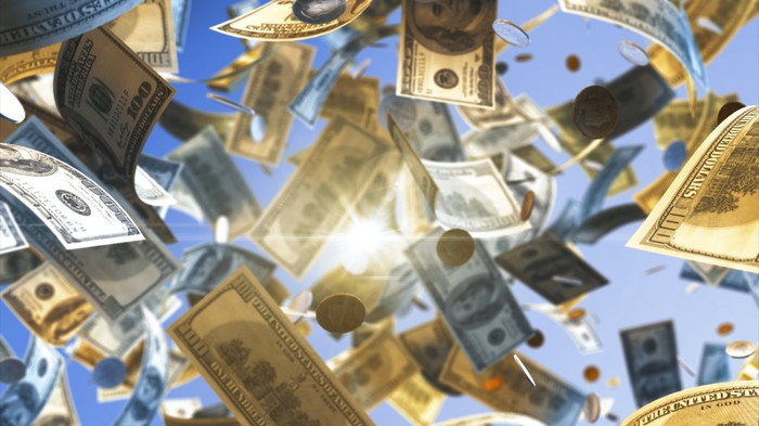 $100 bills and coins falling from the sky/