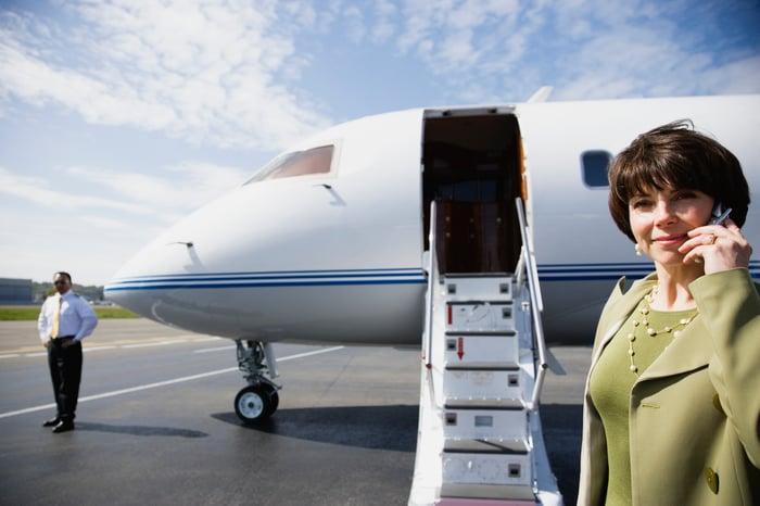 Woman boarding private jet
