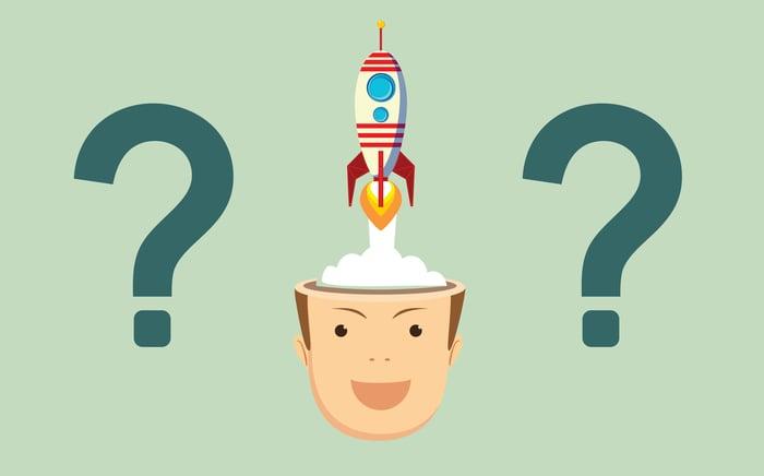 Un dessin animé montre un lancement de fusée depuis l'intérieur de la tête d'un analyste entouré de points d'interrogation