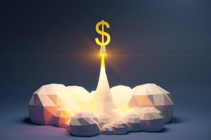 Un signe dollar lancé comme une fusée.