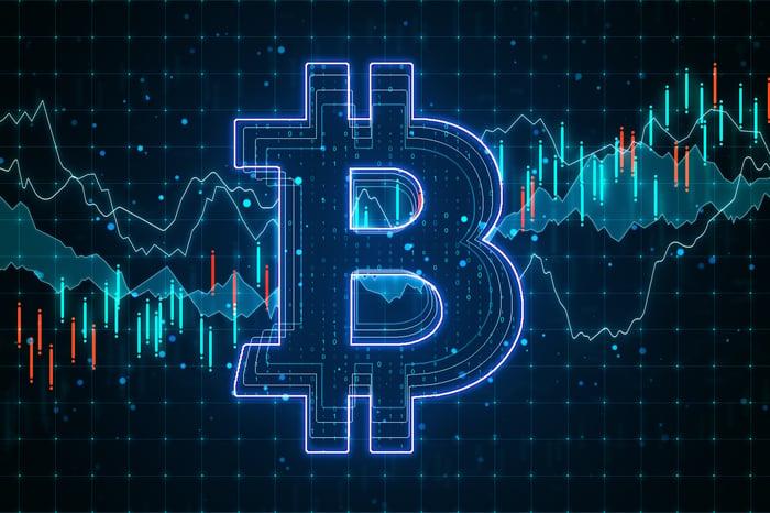 Blue Bitcoin logo on graphic screen