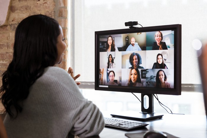 People having a meeting via a video conference.